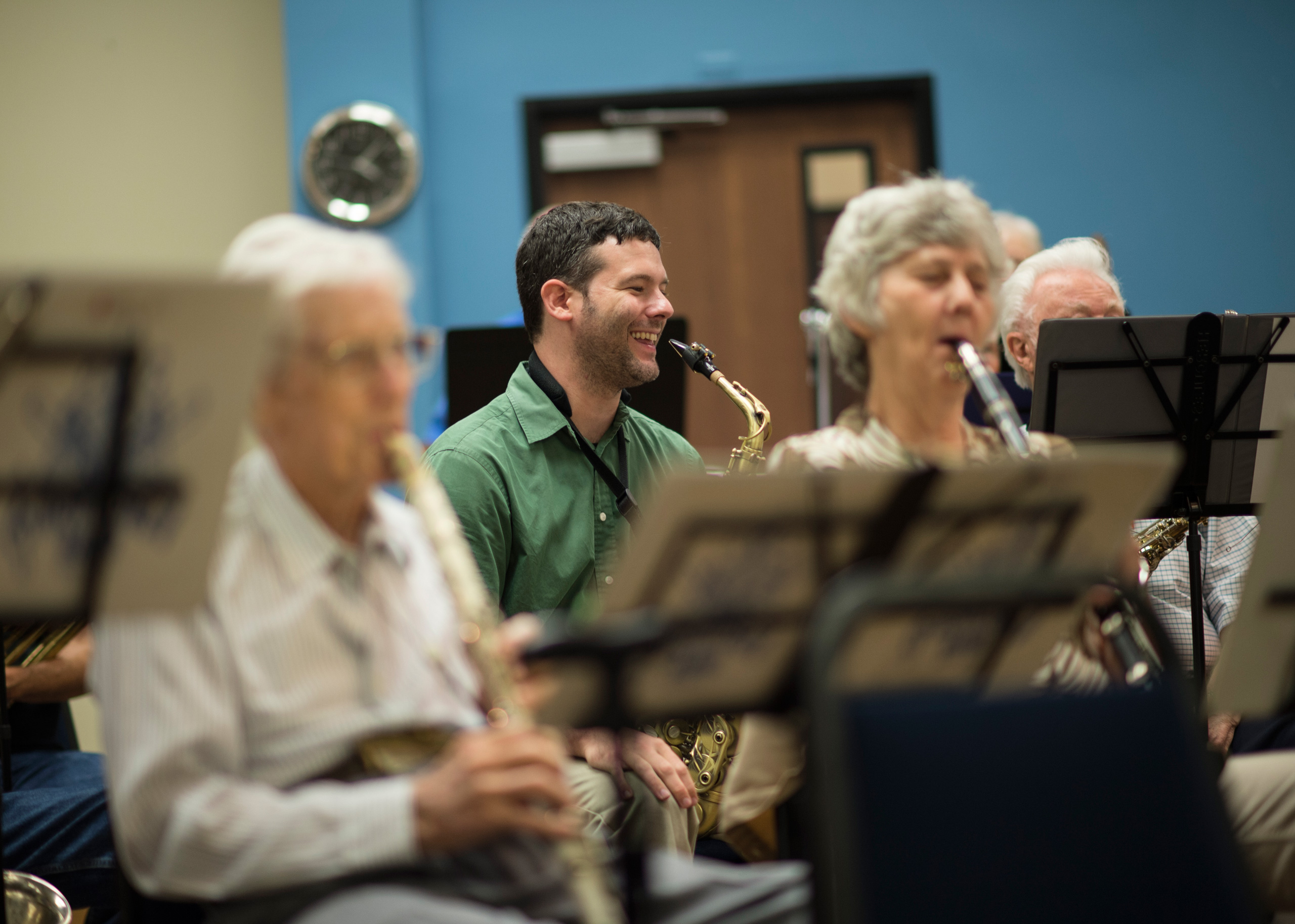 John Denis (center), music education teaching fellow, plays saxophone with the New Horizons Band. Photo by Ahna Hubnik.