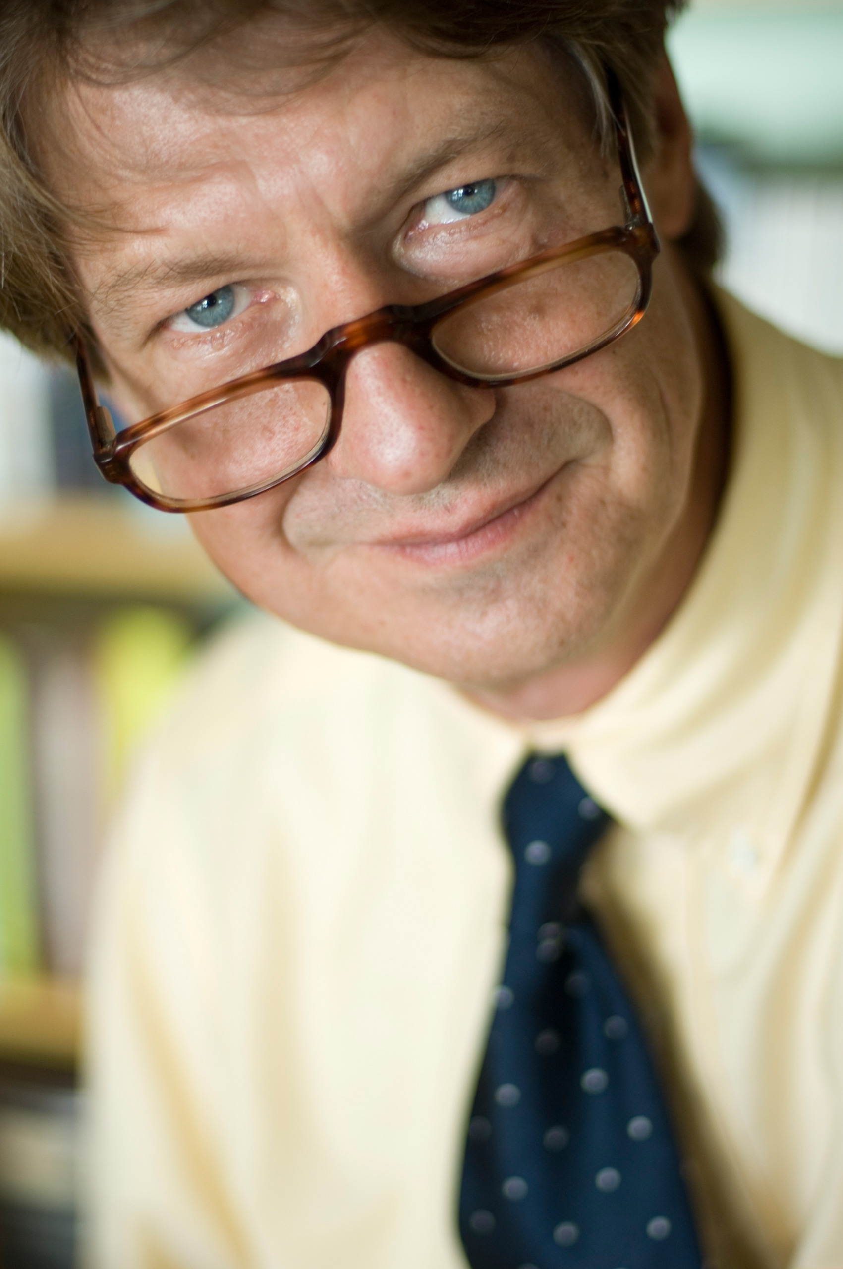 P. J. O'Rourke, close up of O'Rourke looking over his glasses