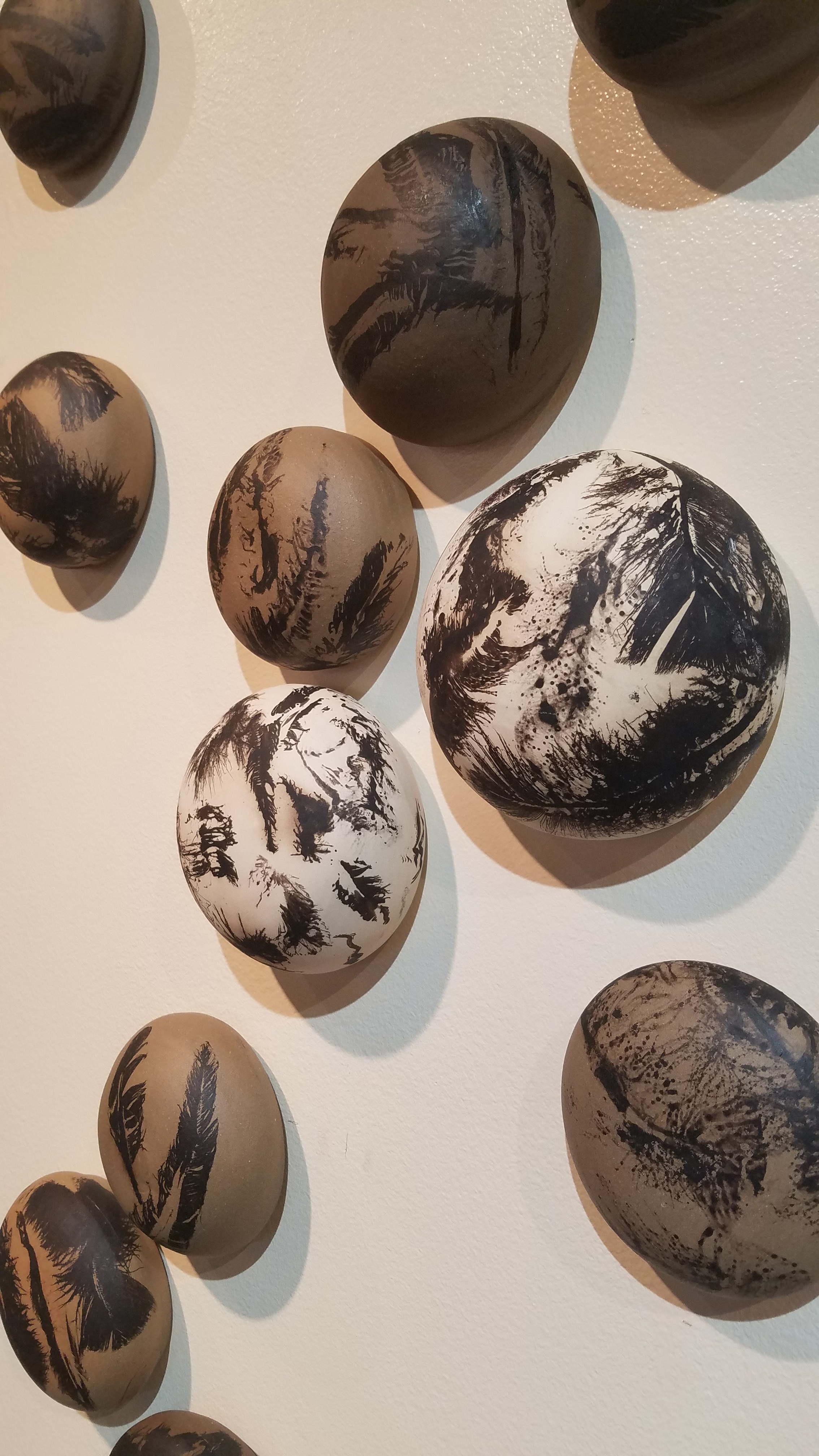 Anna Lee raku ceramics featuring carbon feather imprints