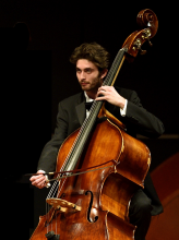 Double bass player in concert