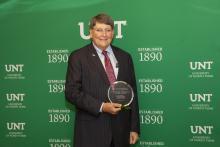 "Jerome ""Bruzzy"" Westheimer with UNT alumni award"