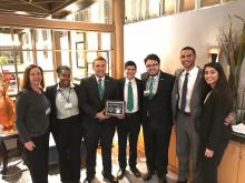 UNT students and their advisor pose after winning a major logistics competition.
